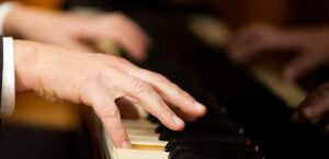 Adult student of Linda Fotis playing piano at lessons
