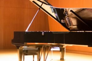 Baby Grand Piano on Stage for Joy of Music piano lessons and piano tuning in Washington DC