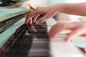Two Adults hands practicing piano at lesson with Linda Fotis